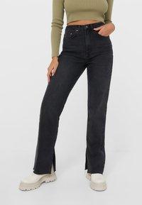 Stradivarius - Straight leg jeans - black - 0