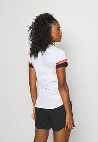 Nike Performance - W NK DF ACADEMY21  - T-shirt sportiva - white/black/bright crimson - 2