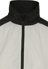 Urban Classics - CRINKLE BATWING  - Training jacket - black/white - 2