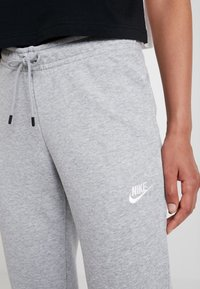 Nike Sportswear - PANT TIGHT - Tracksuit bottoms - dark grey heather/white - 5