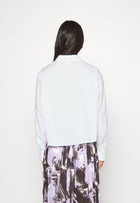 Monki - TAY SHIRT - Button-down blouse - white - 2