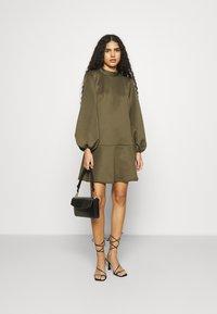 Closet - HIGH NECK PEPLUM DRESS - Day dress - khaki - 1