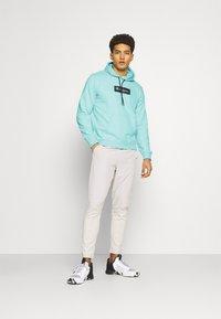 Champion - HOODED - Sweatshirt - turquoise - 1