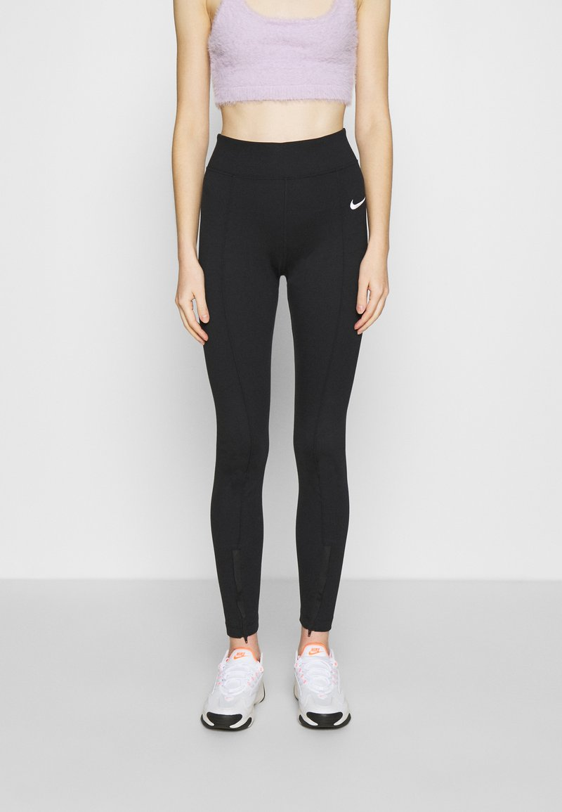 Nike Sportswear - LEGASEE  - Leggings - black