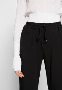 Repeat - TROUSER - Tracksuit bottoms - black - 4