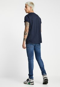 Diesel - SLEENKER - Jeans Skinny - dark-blue denim