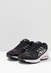 Mizuno - WAVE ULTIMA 11 - Neutral running shoes - white/black - 2