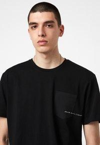 AllSaints - SCRIPTURE SS CREW - Print T-shirt - black - 1