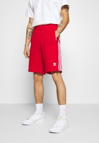 adidas Originals - 3-STRIPE UNISEX - Tracksuit bottoms - red - 0