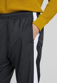 Nike SB - SHIELD - Tracksuit bottoms - black/white - 4