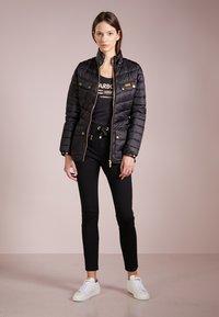 Barbour International - GLEANN QUILT - Light jacket - black - 1