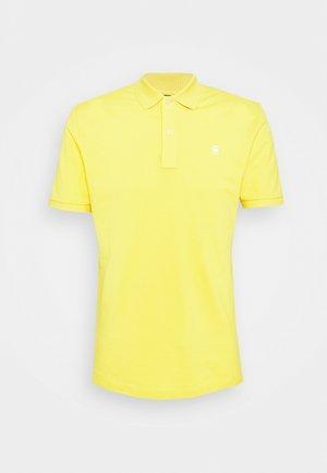DUNDA SLIM - Polo shirt - yellow cab