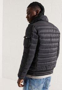 Superdry - FUJI  - Winter jacket - black - 1