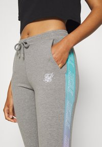 SIKSILK - FADE RUNNER TRACK PANTS - Tracksuit bottoms - grey marl - 5