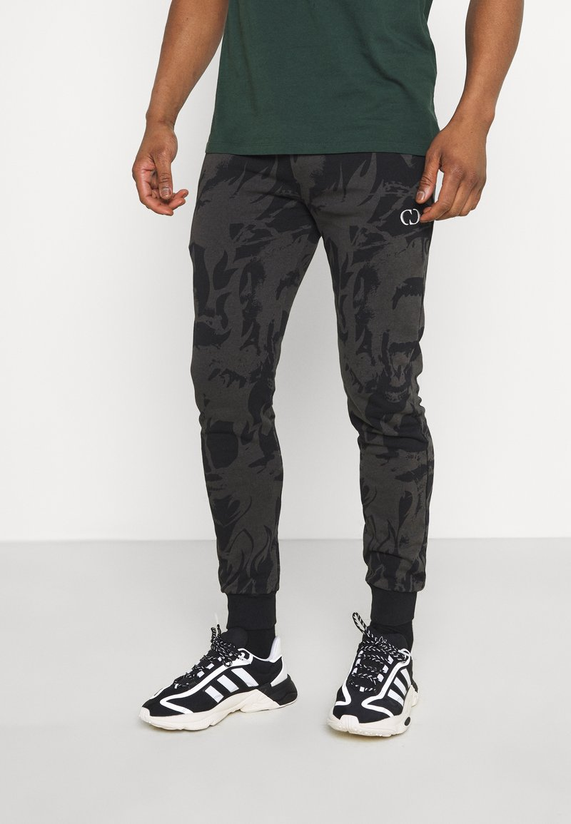 Criminal Damage - ABSTRACT JOGGER - Tracksuit bottoms - black