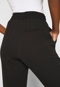 Vero Moda - VMSAGA STRING PANT - Trousers - black - 5