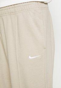 Nike Sportswear - Tracksuit bottoms - beige - 6