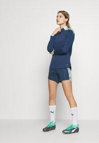 Puma - FTBLNXT 1/4 ZIP - Sports shirt - dark denim/mist green - 1