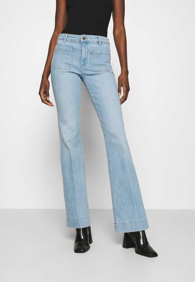 Jeans a zampa - clear blue