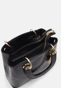 DKNY - TONI SATCHEL MINI SHINY EMBOSSED CROCO - Handbag - black/gold - 3