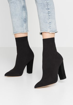 NICHOLETTA - High heeled ankle boots - black