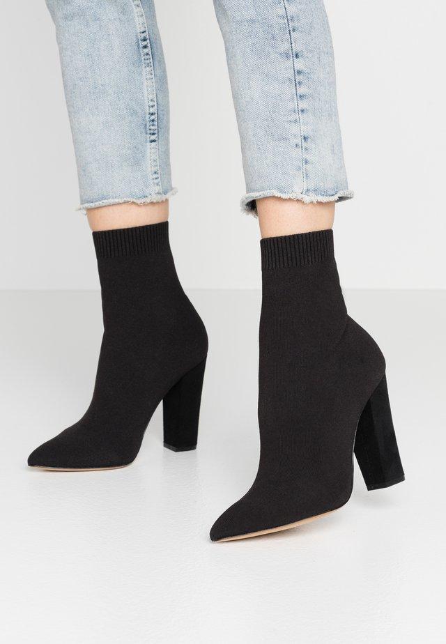 NICHOLETTA - Kotníková obuv na vysokém podpatku - black