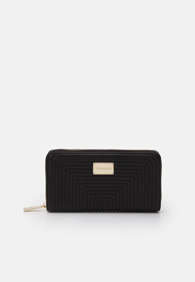QUILTED ZIP AROUND - Wallet - black