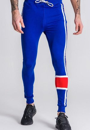 ASYMMETRIC  - Pantalones deportivos - royal blue