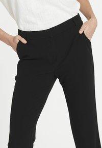 Jascha Stockholm - Pantalon classique - black - 3