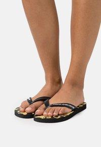 Versace Jeans Couture - T-bar sandals - black - 0