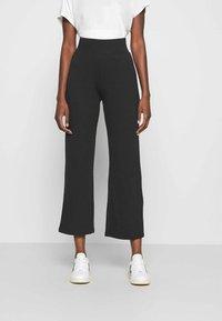 CALANDO - Teplákové kalhoty - black - 0