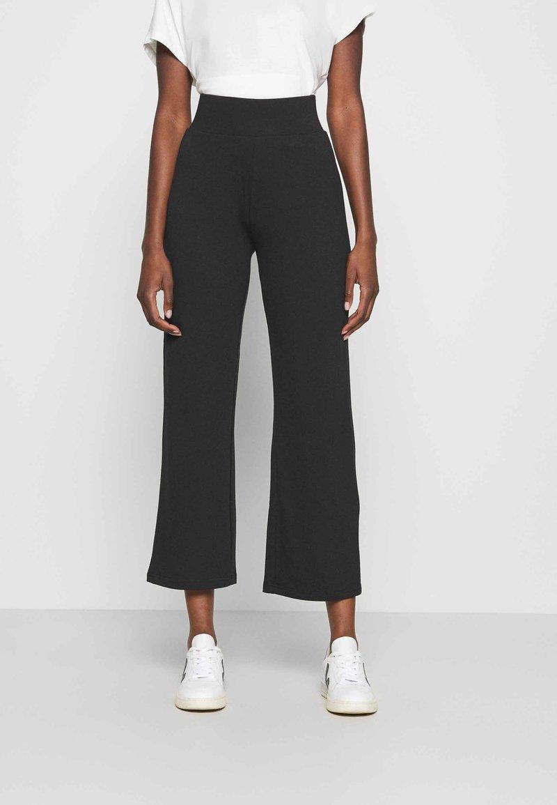 CALANDO - Teplákové kalhoty - black