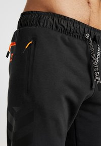 Superdry - COMBAT BOXER JOGGER - Tracksuit bottoms - black - 3