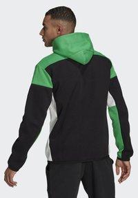 adidas Performance - Z.N.E HOODIE PRIMEGREEN HOODED TRACK TOP - Zip-up hoodie - black - 1