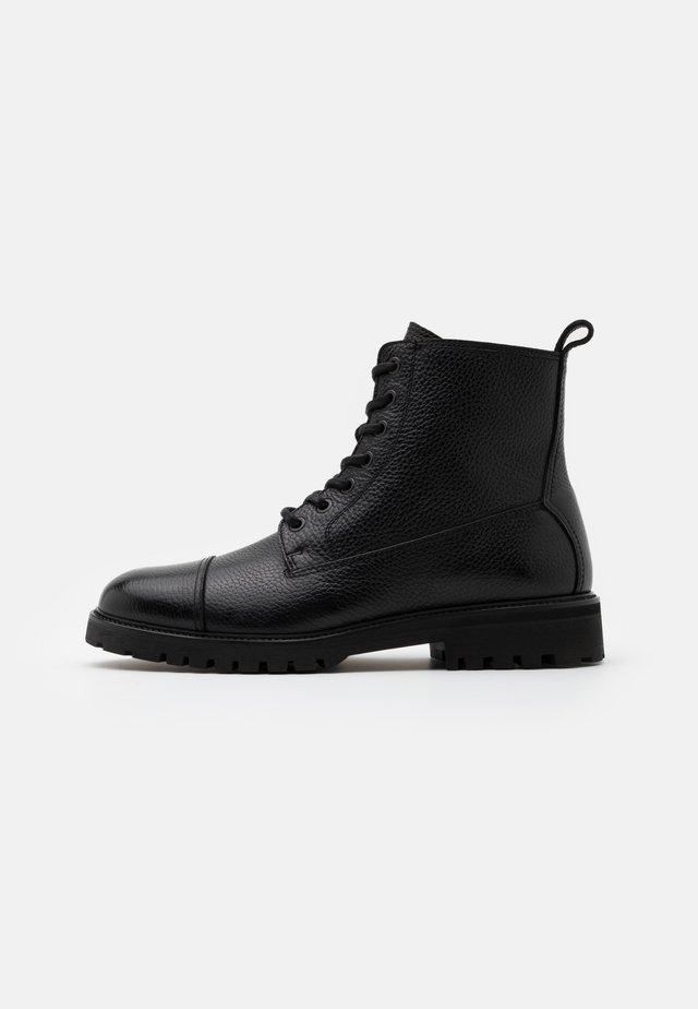 ALPERTON - Bottines à lacets - black