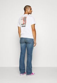 Diesel - ZATINY-X - Bootcut jeans - 009ei - 2