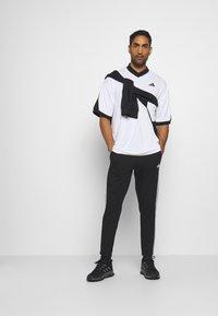 adidas Performance - STRIPES MUST HAVES SPORTS REGULAR PANTS - Verryttelyhousut - black - 1