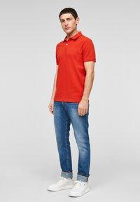 s.Oliver - Polo shirt - orange - 1
