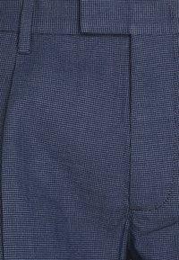 Tommy Hilfiger Tailored - SPRING BIRDS EYE - Trousers - desert sky - 5