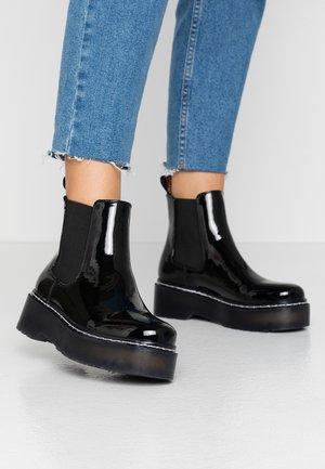 STORM - Kotníková obuv - black