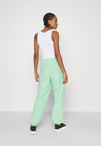 NA-KD - NA-KD X ZALANDO EXCLUSIVE - SPORTY FABRIC PANTS - Tracksuit bottoms - fresh mint - 2