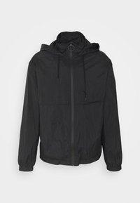 PARKA UNISEX - Summer jacket - black