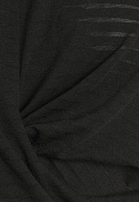 Puma - STUDIO TWIST BURNOUT TEE - Print T-shirt - black - 2
