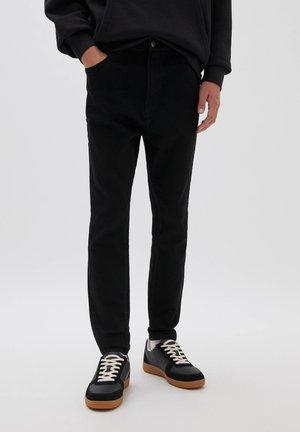 Jean slim - mottled black