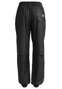 Rains - UNISEX TROUSERS - Teplákové kalhoty - black - 1
