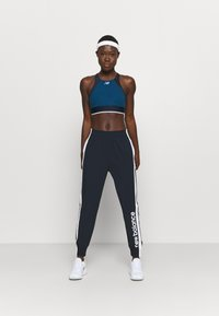 New Balance - ACHIEVER - Tracksuit bottoms - eclipse - 1