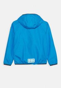 LEGO Wear - JORI 201 JACKET UNISEX - Vodotěsná bunda - light blue - 1