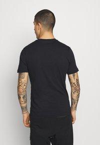Nike Sportswear - TEE MULTIBRAND  - Print T-shirt - black - 2