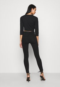 New Look - CLEAN DISCO KIND - Jeansy Skinny Fit - black - 2