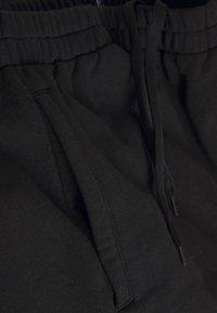 Weekday - KAMA  - Tracksuit bottoms - black - 6